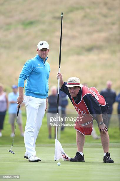 Jamie Donaldson of Wales with caddy Mick Donaghy on the 16th green during the first round of the ISPS Handa Wales Open at Celtic Manor Resort on...