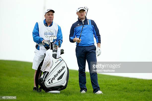 Jamie Donaldson of Wales with his caddy Mick Donaghy during his first round match against Paul Casey of England at the Volvo World Matchplay...
