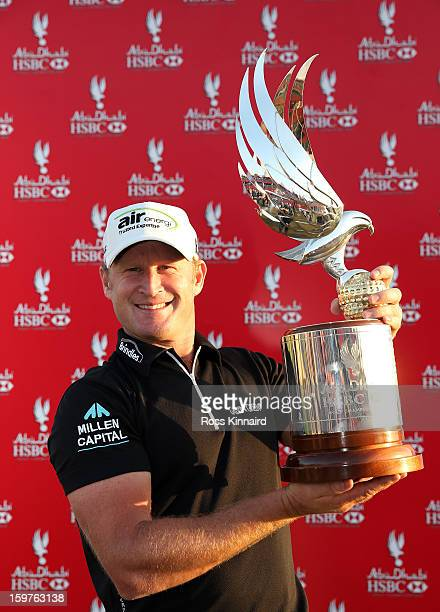 Jamie Donaldson of Wales with the winners trophy after the final round of the Abu Dhabi HSBC Golf Championship at the Abu Dhabi Golf Club on January...