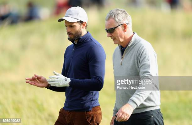 Jamie Dornan Actor and Aidan Heavey in conversation during the final round of the 2017 Alfred Dunhill Championship at The Old Course on October 8...