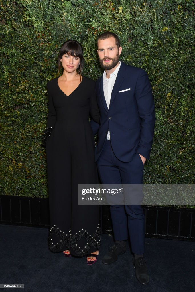 Jamie Dornan and Amelia Warner attend Charles Finch and CHANEL Pre-Oscar Awards Dinner at Madeo Restaurant on February 25, 2017 in Los Angeles, California.