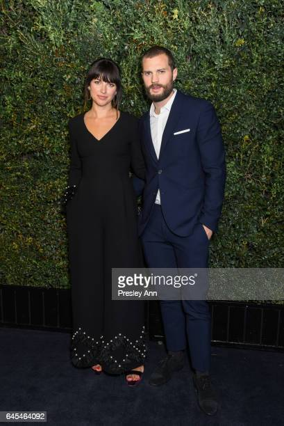 Jamie Dornan and Amelia Warner attend Charles Finch and CHANEL PreOscar Awards Dinner at Madeo Restaurant on February 25 2017 in Los Angeles...