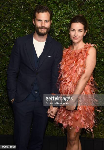 Jamie Dornan and Amelia Warner attend Charles Finch and Chanel PreOscar Awards Dinner at Madeo in Beverly Hills on March 3 2018 in Beverly Hills...
