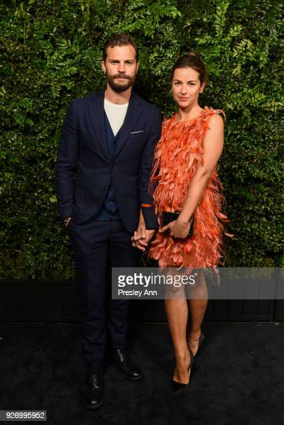 Jamie Dornan and Amelia Warner attend Charles Finch And Chanel PreOscar Awards Dinner At Madeo in Beverly Hills at Madeo Restaurant on March 3 2018...