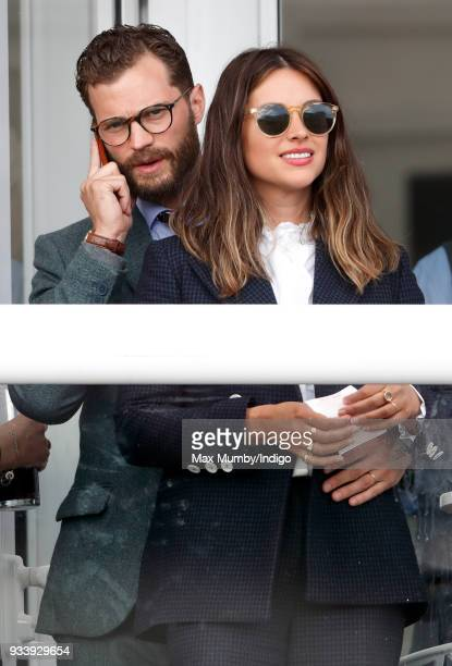 Jamie Dornan and Amelia Warner attend day 4 'Gold Cup Day' of the Cheltenham Festival at Cheltenham Racecourse on March 16 2018 in Cheltenham England