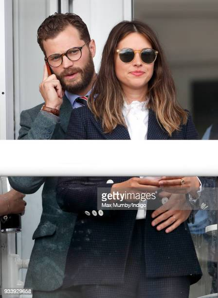 Jamie Dornan and Amelia Warner attend day 4 'Gold Cup Day' of the Cheltenham Festival at Cheltenham Racecourse on March 16 2018 in Cheltenham England...