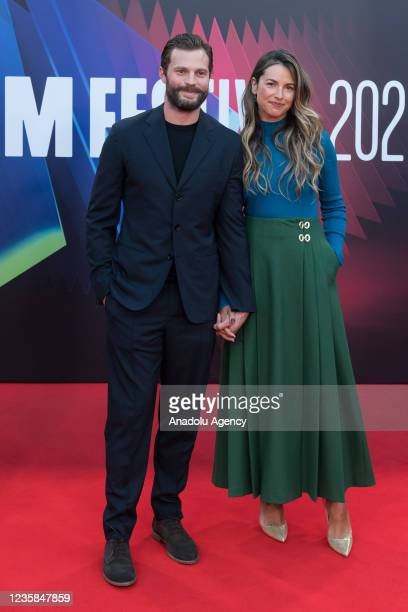 Jamie Dornan and Amelia Warner attend the European film premiere of 'Belfast' at the Royal Festival Hall during the 65th BFI London Film Festival in...