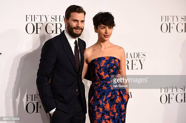 Jamie Dornan and Amelia Warner attend the UK Premiere of Fifty Shades Of Grey at Odeon Leicester Square on February 12 2015 in London England