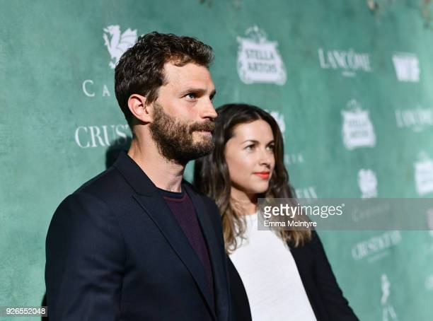 Jamie Dornan and Amelia Warner attend Women In Film PreOscar Cocktail Party presented by Max Mara and Lancome with additional support from Crustacean...