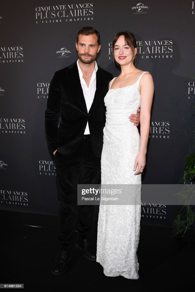 Jamie Dornan and Dakota Johnson attend 'Fifty Shades Freed - 50 Nuances Plus Claires' Premiere at Salle Pleyel on February 6, 2018 in Paris, France.