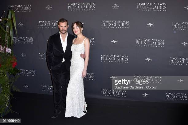 Jamie Dornan and Dakota Johnson attend the Fifty Shades Freed 50 Nuances Plus Clair Paris Premiere at Salle Pleyel on February 6 2018 in Paris France