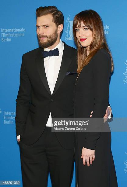 Jamie Dornan and Dakota Johnson attend the 'Fifty Shades of Grey' premiere during the 65th Berlinale International Film Festival at Zoo Palast on...