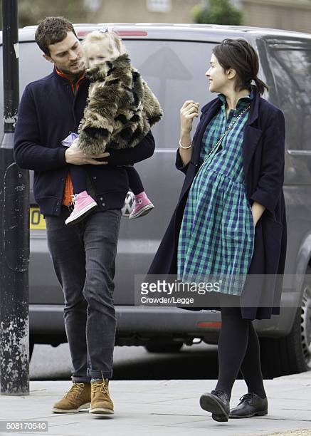 Jamie Dornan and heavily pregnant wife Amelia Warner are pictured out on February 3 2016 in London England