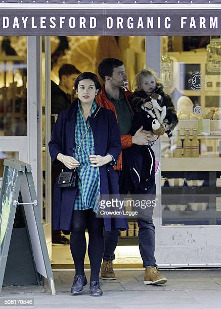 Jamie Dornan and heavily pregnant wife Amelia Warner leave the Daylesford Organic shop on February 3 2016 in London England