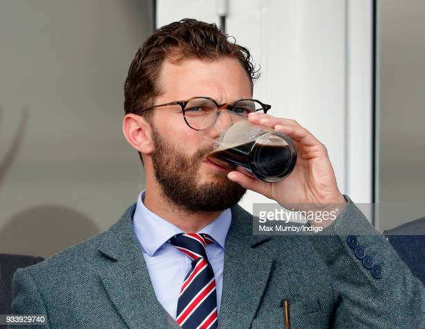Jamie Dornan attends day 4 'Gold Cup Day' of the Cheltenham Festival at Cheltenham Racecourse on March 16 2018 in Cheltenham England