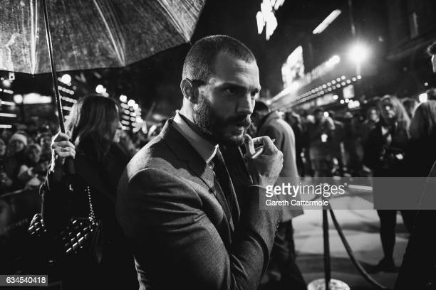 Jamie Dornan signs for fans during the UK premiere of 'Fifty Shades Darker' at Odeon Leicester Square on February 9 2017 in London England