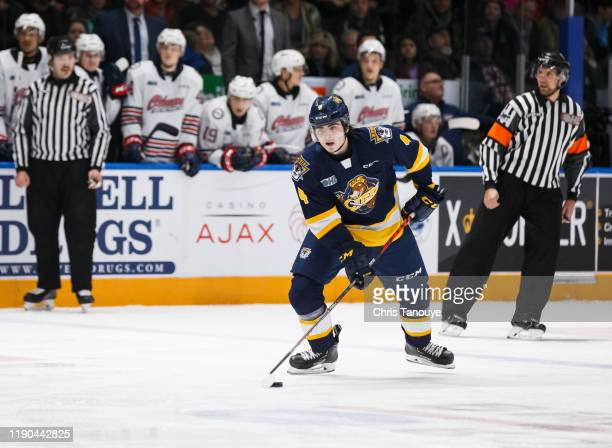 Jamie Drysdale of the Erie Otters skates with the puck during an OHL game against the Oshawa Generals at the Tribute Communities Centre on November...