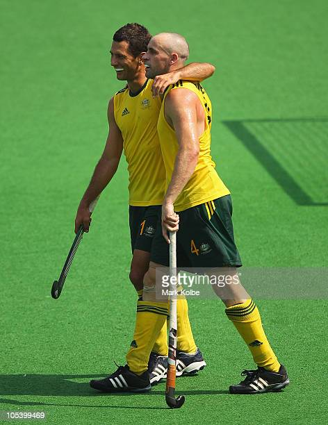 Jamie Dwyer and Glenn Turner of Australia celebrate winning the Men's Gold medal match between Australia and India at the Major Dhyan Chand National...