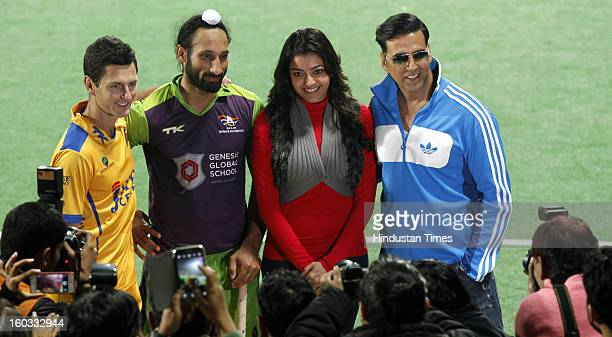 Jamie Dwyer and Sardar Singh with Actor Kajal Aggarwal and Akshay Kumar during Hockey India League match between Delhi Waveriders and Punjab Warriors...
