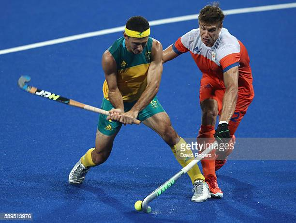 Jamie Dwyer of Australia is challenged by Sander de Wijn during the Men's hockey quarter final match between the Netherlands and Australia on Day 9...