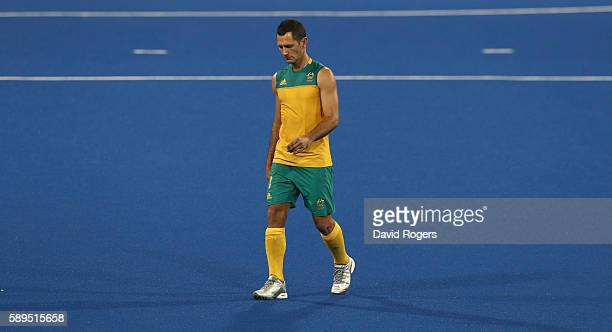 Jamie Dwyer of Australia looks dejected as he leaves the pitch after Australia's 4-0 defeat during the Men's hockey quarter final match between the...