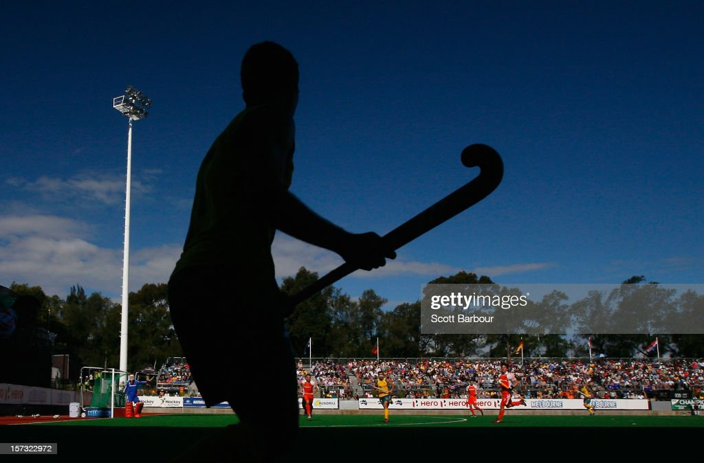 Jamie Dwyer of Australia prepares to hit the ball into play during the match between Australia and the Netherlands during day two of the Champions Trophy on December 2, 2012 in Melbourne, Australia.