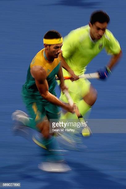 Jamie Dwyer of Australia runs upfield with the ball against Brazil during a Men's Preliminary Pool B match on Day 7 of the Rio 2016 Olympic Games at...