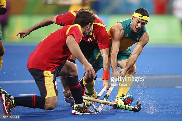 Jamie Dwyer of Australia takes on the defence during the men's pool A match between Brazil and Belgium on Day 2 of the Rio 2016 Olympic Games at the...