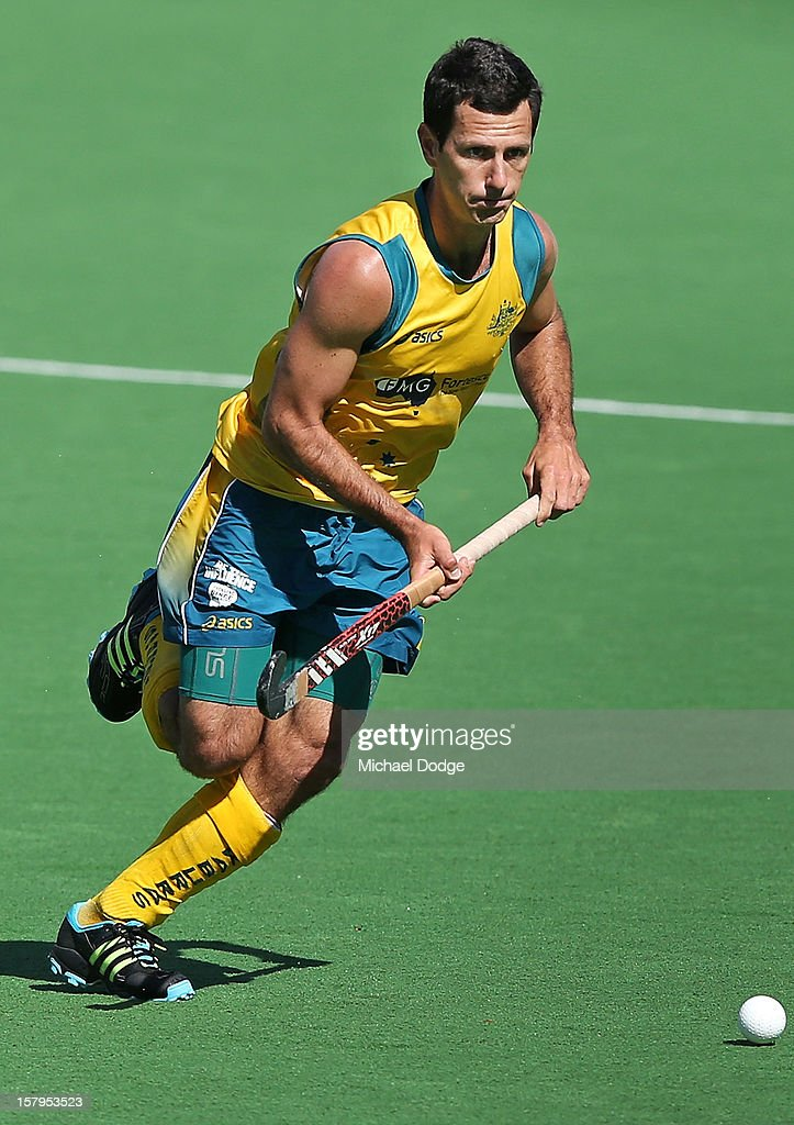 Jamie Dywer of Australia runs with the ball in the match between Australia and India during day five of the 2012 Champions Trophy at the State Netball and Hockey Centre on December 8, 2012 in Melbourne, Australia.
