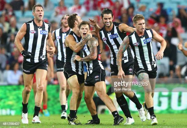 Jamie Elliot of the Magpies celebrates a goal during the round two AFL match between the Sydney Swans and the Collingwood Magpies at ANZ Stadium on...