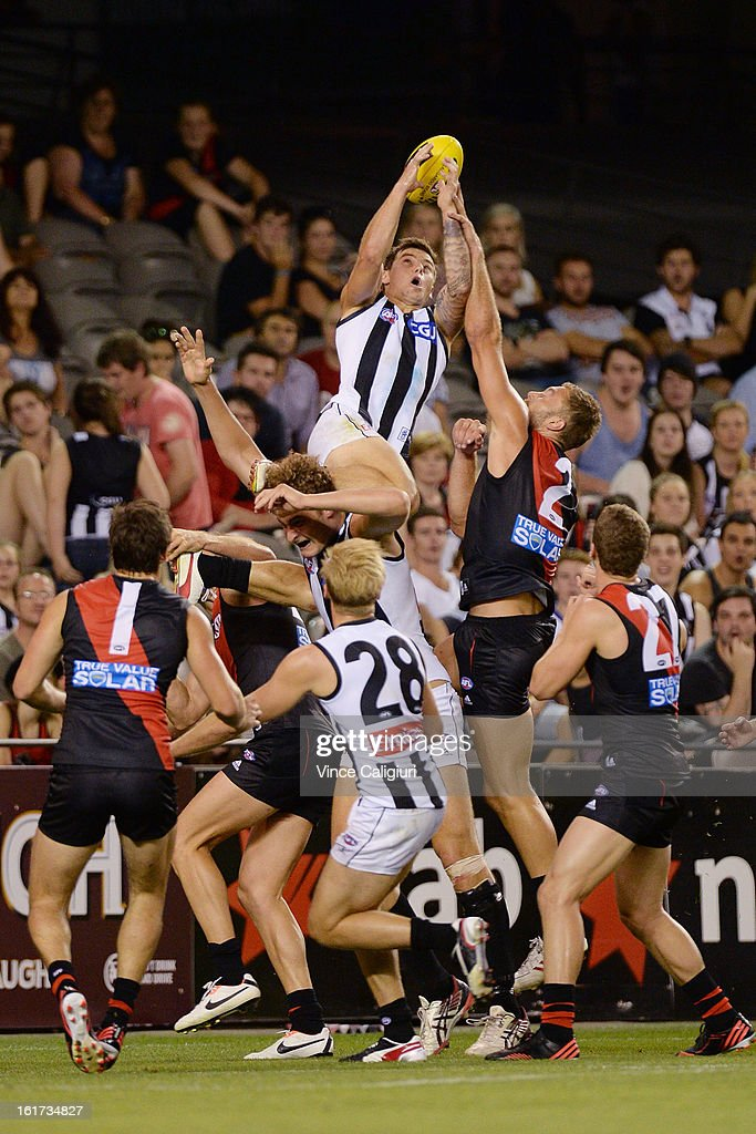 Jamie Elliott of the magpies leaps high above the pack but fails to hold onto the mark during the round one AFL NAB Cup match between the Collingwood Magpies and the Essendon Bombers at Etihad Stadium on February 15, 2013 in Melbourne, Australia.