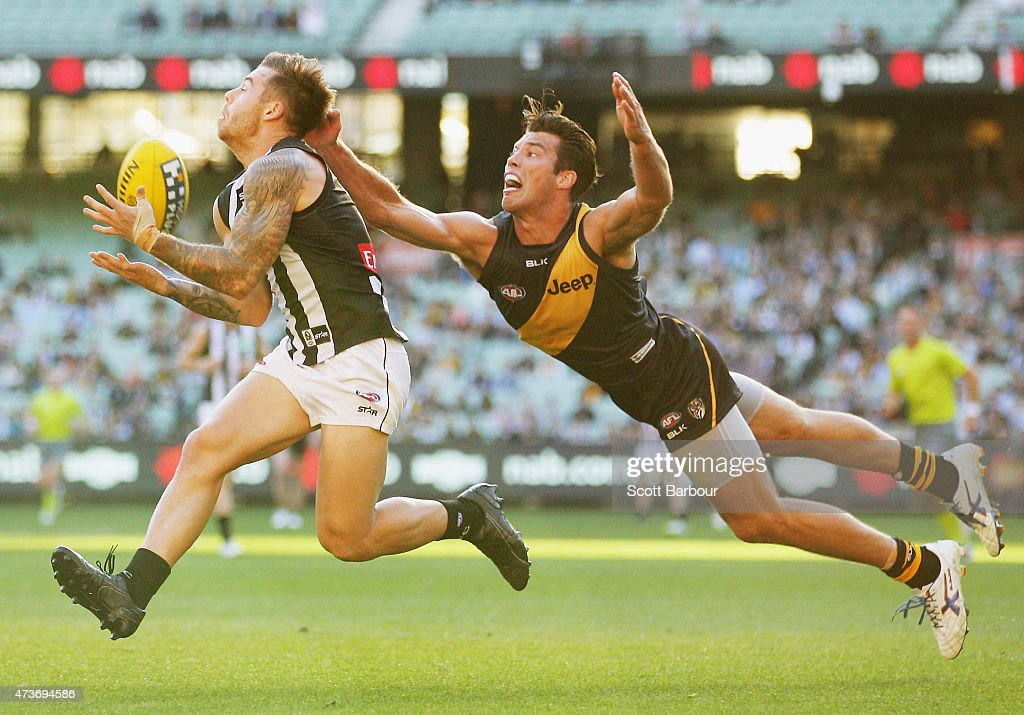 Jamie Elliott of the Magpies takes a mark in front of Alex Rance of the Tigers during the round seven AFL match between the Richmond Tigers and the Collingwood Magpies at the Melbourne Cricket Ground on May 17, 2015 in Melbourne, Australia.