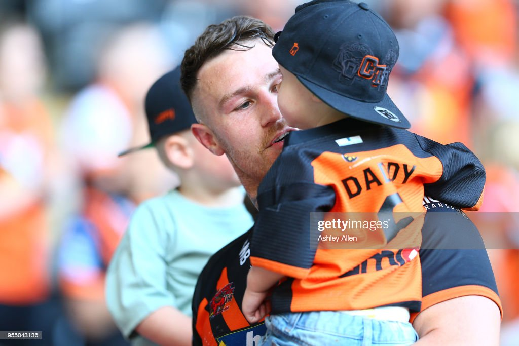 Jamie Ellis of Castleford Tigers and his son during the Betfred Super League match between Hull FC and Castleford Tigers at KCOM Stadium on May 5, 2018 in Hull, England.