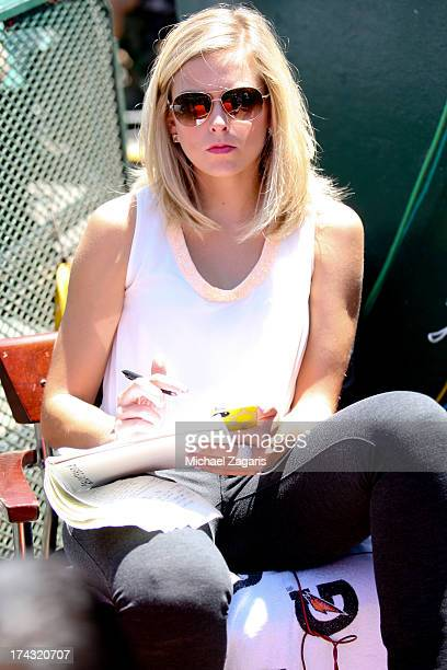 Jamie Erdahl of the NESN Network sits outside the dugout during the game between the Oakland Athletics and the Boston Red Sox at Oco Coliseum on July...