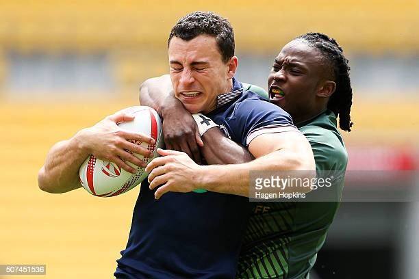 Jamie Farndale of Scotland is tackled by Seabelo Senatla of South Africa during the 2016 Wellington Sevens pool match between South Africa and...