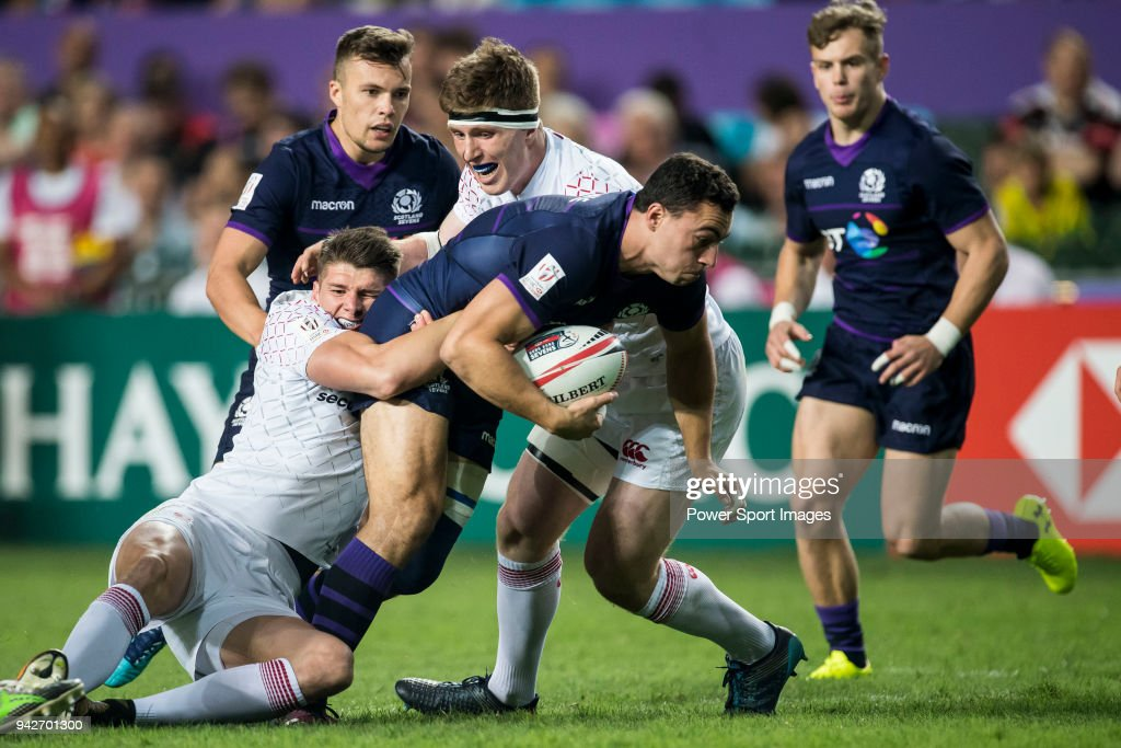 Jamie Farndale of Scotland is tackled by the England defence during their Pool C match between England and Scotland as part of the HSBC Hong Kong Rugby Sevens 2018 on April 6, 2018 in Hong Kong, Hong Kong.