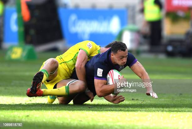 Jamie Farndale of Scotland tackled by Lachie Anderson of Australia during day 1 of the HSBC Cape Town Sevens Pool D match 18 between Australia vs...