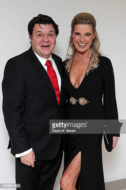 Jamie Foreman and Julie Dennis attend the Amy Winehouse Foundation Ball at the Dorchester Hotel on November 20 2013 in London England