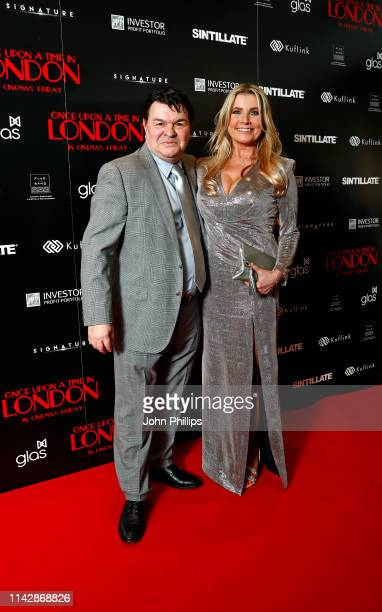 "Jamie Foreman and Julie Dennis attend the ""Once Upon A Time in London"" world premiere at Troxy on April 15, 2019 in London, England."