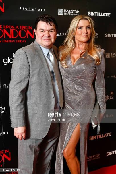 Jamie Foreman and Julie Dennis attend the Once Upon A Time in London world premiere at Troxy on April 15 2019 in London England