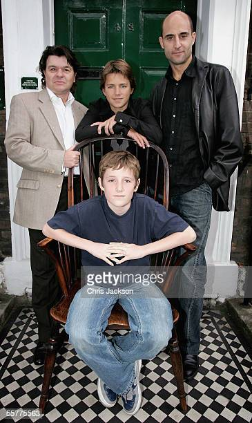 Jamie Foreman Harry Eden Mark Strong and Barney Clark who plays Oliver Twist poses at the photocall for Roman Polanski's new production of Charles...