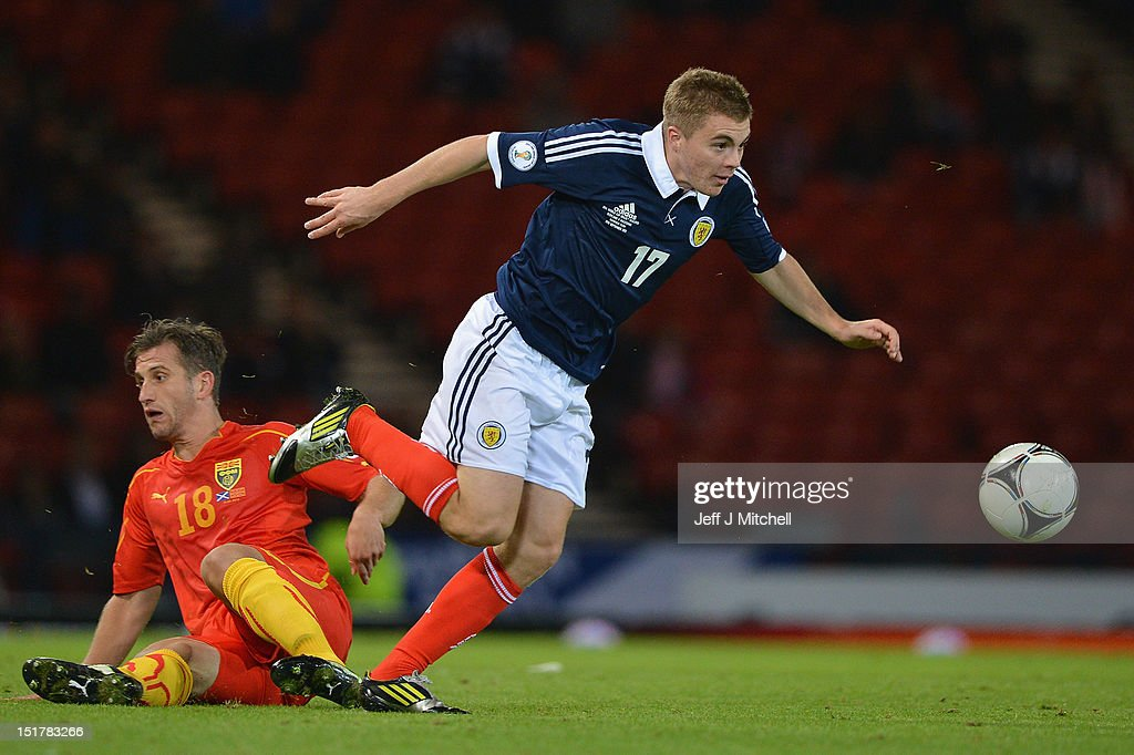 Jamie Forrest of Scotland tackles Muhamed Demiri of Macedonia during the FIFA World Cup Qualifier Between Scotland and Macedonia at Hampden Park on September 11, 2012 in Glasgow, Scotland.
