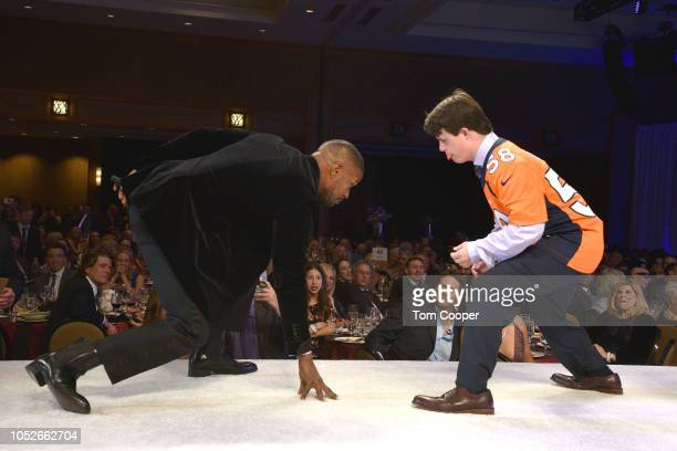 Jamie Foxx and Andrew Goodspeed at the Global Down Syndrome 10th anniversary BBBY fashion show at Sheraton Denver Downtown Hotel on October 20 2018...