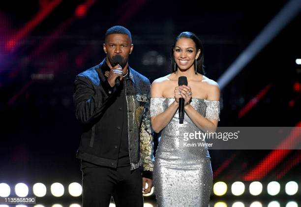 Jamie Foxx and Corinne Foxx speak on stage at the 2019 iHeartRadio Music Awards which broadcasted live on FOX at the Microsoft Theater on March 14...