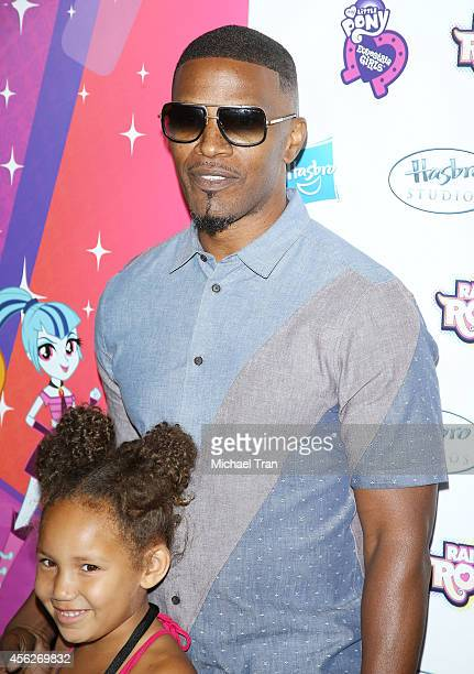 Jamie Foxx and daughter Annalise Bishop arrive at the Los Angeles premiere of 'My Little Pony Equestria Girls Rainbow Rocks' held at TCL Chinese 6...
