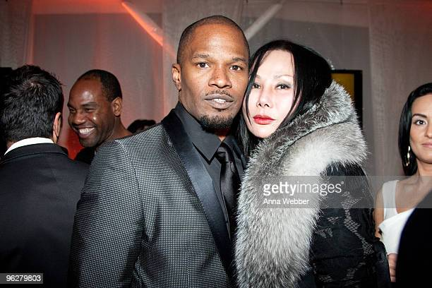 Jamie Foxx and Eva Chow attend L'Ermitage on January 29 2010 in Los Angeles California