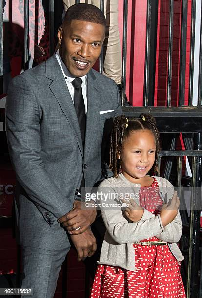 Jamie Foxx and his daughter Annalise Bishop attend the 'Annie' world premiere at Ziegfeld Theater on December 7 2014 in New York City