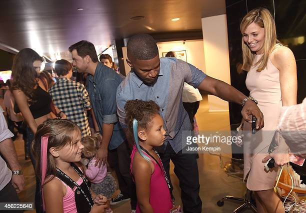 Jamie Foxx and his daughter Annalise Bishop attend the premiere of My Little Pony Equestria Girls Rainbow Rocks at TCL Chinese Theatre on September...