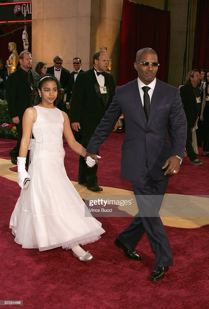 Jamie Foxx and his daughter arrive at the 77th Annual Academy Awards at the Kodak Theater on February 27, 2005 in Hollywood, California.