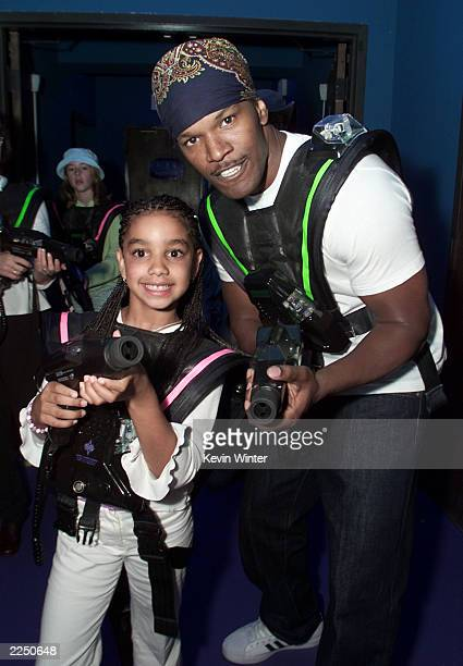 Jamie Foxx and his daughter Corinne prepare for battle in the Lazer Tag room at the afterparty for the world premiere of 'Atlantis The Lost Empire'...